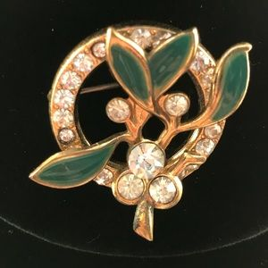 Vintage golden wreath pin with green leaves